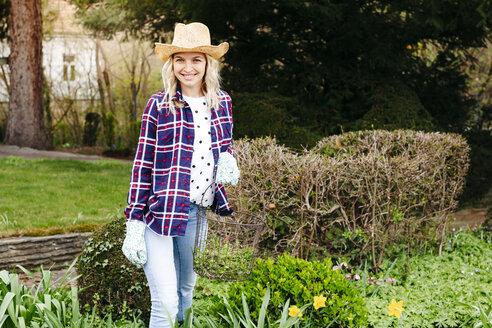 Young woman gardening, basket - HMEF00290