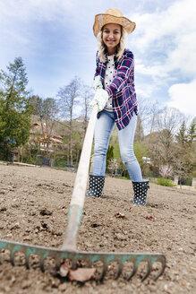 Young woman raking - HMEF00302