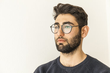 Portrait of pensive young man with beard and glasses - TCF06079