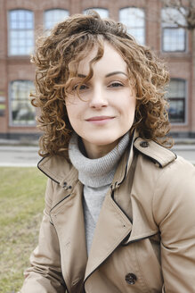 Portrait of smiling woman with curly hair - EYAF00157
