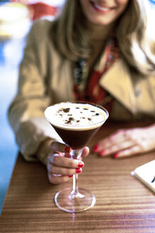 Close-up of woman with a coffee cocktail in a cafe - ERRF01070