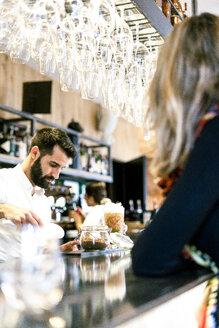 Sevilla, Spain, woman, coffee shop, fall, tea, cocktail, barman - ERRF01130