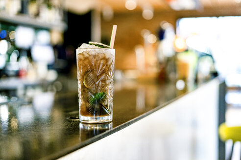 Close-up of cocktail on counter of a bar - ERRF01136
