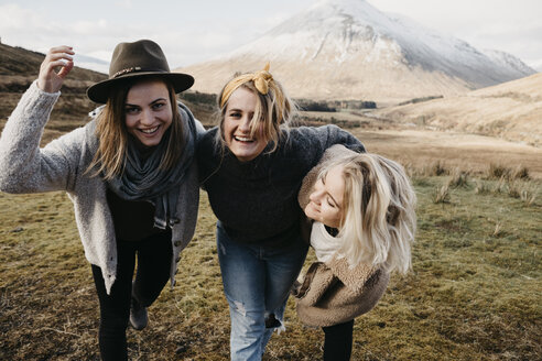 UK, Scotland, Loch Lomond and the Trossachs National Park, happy female friends in rural landscape - LHPF00559