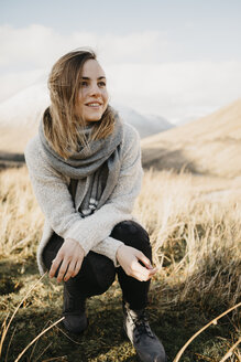 UK, Scotland, Loch Lomond and the Trossachs National Park, portrait of smiling young woman in rural landscape - LHPF00568