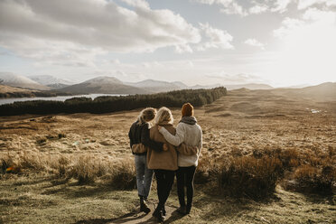 UK, Scotland, Loch Lomond and the Trossachs National Park, rear view of female friends looking at view - LHPF00571