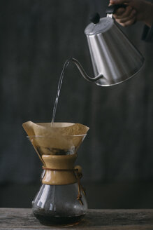 Close-up of man preparing filtered coffee - ALBF00840