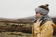 UK, Scotland, Isle of Skye, young woman in rural landscape - LHPF00619