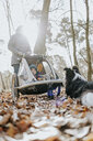 Mother with little daughter in pram and Border Collie in autumnal forest - DWF00428
