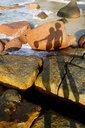 Seychelles, Praslin, Anse Lazio, shadows of couple on rocks at seashore - NDF00884