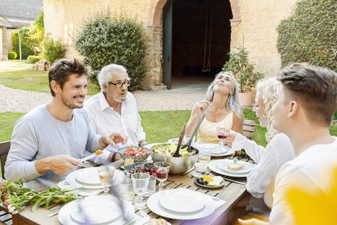Happy family eating together in the garden - PESF01639