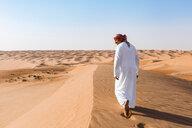 Bedouin walking in the desert, Wahiba Sands, oman - WVF01301