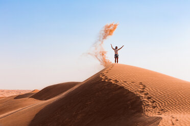 Sultanate Of Oman, Wahiba Sands, Mid adult man is playing with sand in the desert - WVF01349