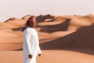 Bedouin in National dress standing in the desert, Wahiba Sands, Oman - WVF01379