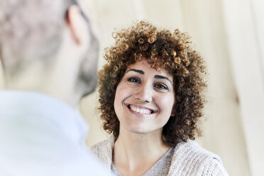 Portrait of smiling woman looking at man - FMKF05596