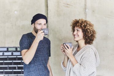 Man and woman drinking coffee together - FMKF05605