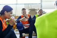 Workers in factory having lunch break together - ZEDF02131