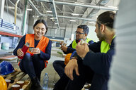 Workers in factory having lunch break together - ZEDF02134