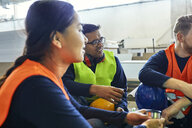 Workers in factory having lunch break together - ZEDF02140