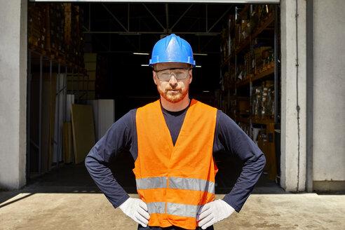 Portrait of confident worker on factory yard - ZEDF02206