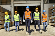 Group of workers walking on factory yard - ZEDF02209