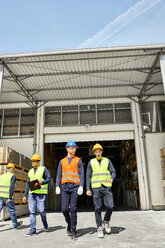 Group of workers walking on factory yard - ZEDF02215
