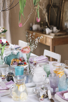 Laid table with floral decoration at springtime - ALBF00862