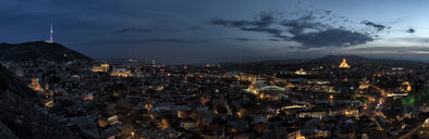 Georgia, Tbilisi, cityscape with Holy Trinity Cathedral at dusk - ALRF01444