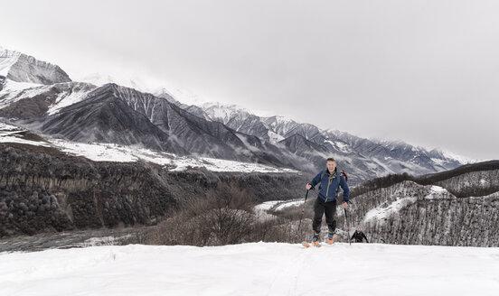 Georgia, Caucasus, Gudauri, man on a ski tour to Lomisi Monastery - ALRF01453