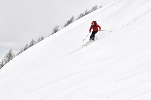 Georgia, Caucasus, Gudauri, man on a ski tour riding downhill - ALRF01465