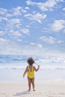 Hispanic girl standing on beach - BLEF00082