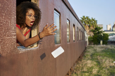 Woman's phone falling out of train window - VEGF00067
