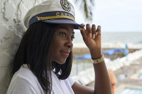 Black woman with captain's cap Restaurant Cais/ Clube Naval, Moçambique, Maputo - VEGF00085