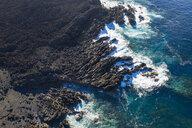 Spain, Canary Islands, Lanzarote, Tinajo, Los Volcanos nature park, aerial view over rocky coast - SIEF08593