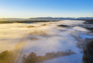 Germany, Bavaria, Loisach, sunrise over winter landscape, aerial view - SIEF08605