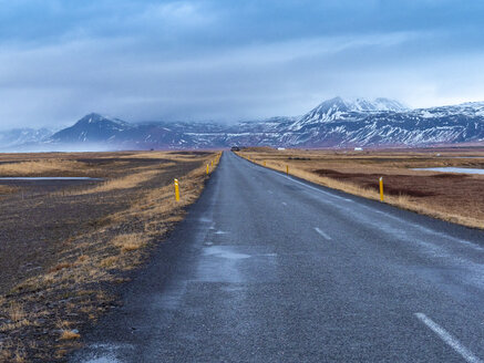 Road 54 at Snæfellsjökull National Park early in the morning with mountains and fog in the background in winter - TAMF01312