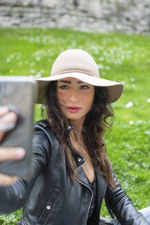 Young woman with hat taking a selfie - MGIF00385