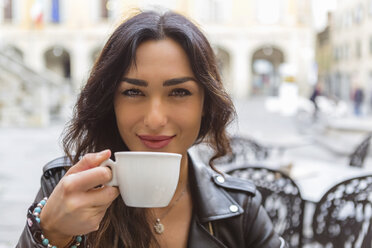 Young woman with cup of coffee - MGIF00400