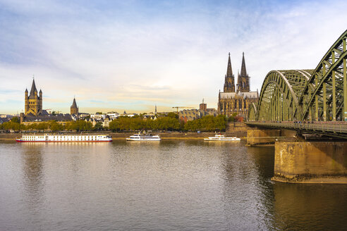 Germany, Cologne, Hohenzollern Bridge and Cologne Cathedral in the morning - TAMF01318