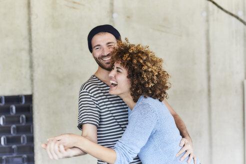 Laughing playful couple dancing - FMKF05618
