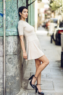 Fashionable young woman wearing a dress in the city - JSMF00978