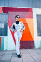 Fashionable young woman posing with colorful urban background - JSMF01017