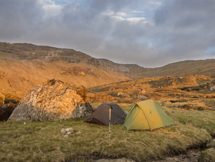 Great Britain, Scotland, Northwest Highlands, Ben More Assynt, mountainscape and tents in morning light - HUSF00041