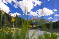 Italy, Trentino Alto Adige, Soraga, view of the village behind Soraga lake - FLMF00178