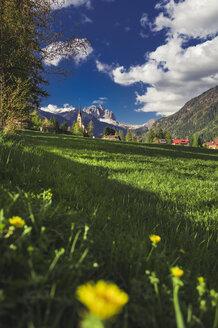 Italy, Trentino Alto-Adige, Vigo di Fassa, view of the town and Dolomites mountains - FLMF00187