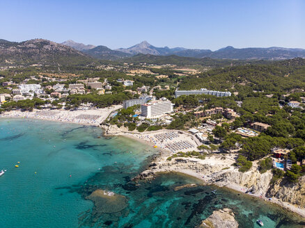 Spain, Majorca, Costa de la Calma, aerial view over Peguera with hotels and beaches - AMF06935