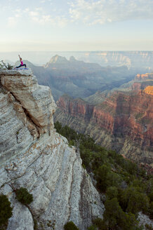 Caucasian woman practicing yoga on cliff near canyon - BLEF00164
