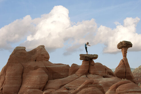 Caucasian woman practicing yoga on top of rock formation - BLEF00167