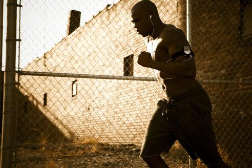 African American man jogging - BLEF00173