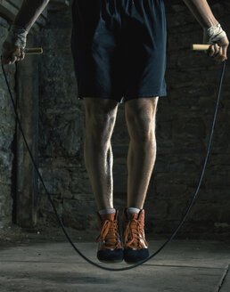 Caucasian boxer training and jumping rope - BLEF00179